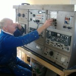 Stan MacNally at the Marconi Main Ships Radio Room Console