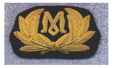 Replica of a Marconi cap badge as would have been worn by Phillips and Bride on Titanic.